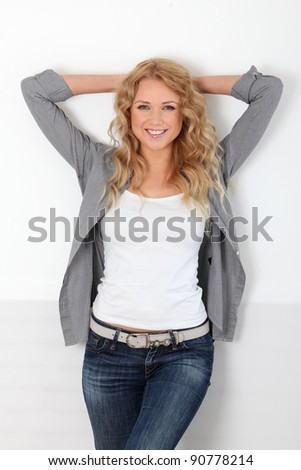 Beautiful blond woman with trendy look - stock photo