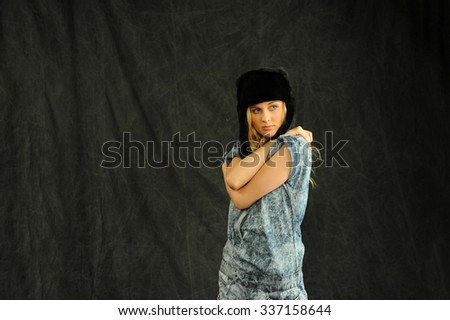 Beautiful Blond women at studio, long hairs, blue jean jacket and pant.