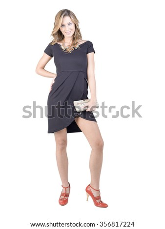 Beautiful blond women in elegant dress in studio, women wearing red shoes and keep hand bag