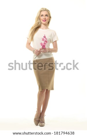beautiful blond young model girl with  flowers  isolated on white studio photo