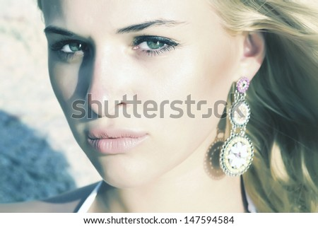 beautiful blond young woman - stock photo