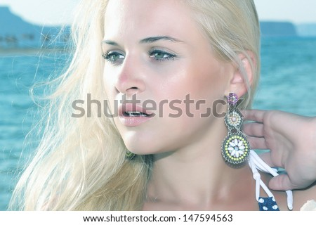 beautiful blond young woman on the beach. nature background