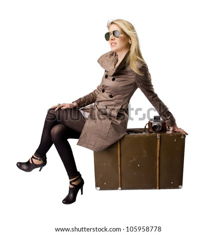 Beautiful blond young woman with suitcase, dressed in retro style. Isolated on white background - stock photo