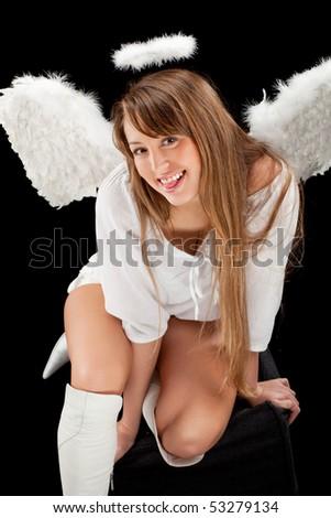 beautiful blonde angel against black background - stock photo
