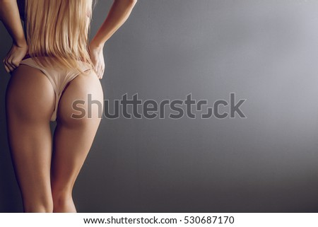 Beautiful blonde ass. Elastic buttocks. Healthy lifestyle diet and fitness. Perfect slim toned young body of the girl. Fitness or plastic surgery and aesthetic cosmetology. elastic ass. Firm buttocks