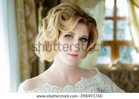 Beautiful blonde Bride portrait wedding makeup and hairstyle  , fashion bride model jewelry and beauty female face, gorgeous beauty bride,bride in luxury wedding dress, - stock photo