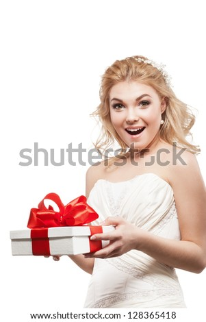 Beautiful blonde bride with white gift box - stock photo