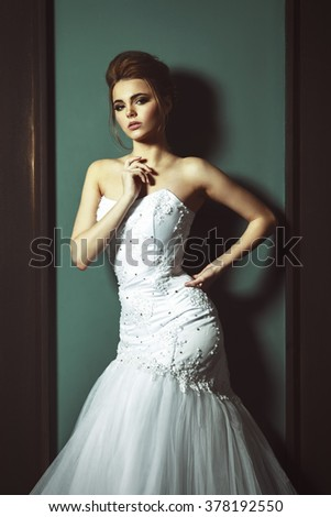 Beautiful Blonde Bride Woman. White Wedding Dress. Vintage Grunge Interior. Soft Light Color Effect