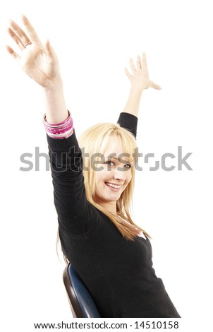 Beautiful blonde business woman with natural makeup with her hands in the air while sitting on a chair