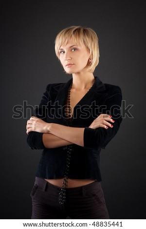 beautiful  blonde bussineswoman on  black background .