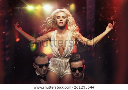 Beautiful blonde celebrity on stage - stock photo