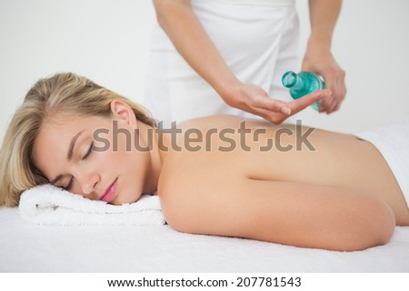 Beautiful blonde enjoying a back massage at the health spa