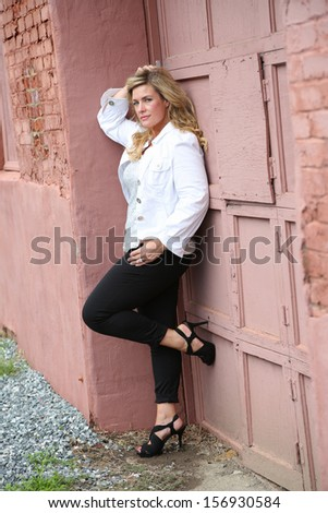 Beautiful Blonde Female Model in Fashion Outfit Posing - stock photo