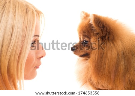 Beautiful, blonde girl and a dog - stock photo