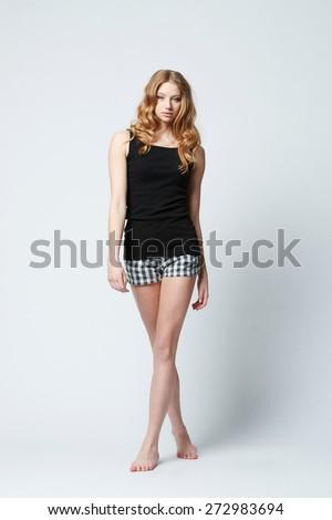beautiful blonde girl casual dressed studio shot - stock photo