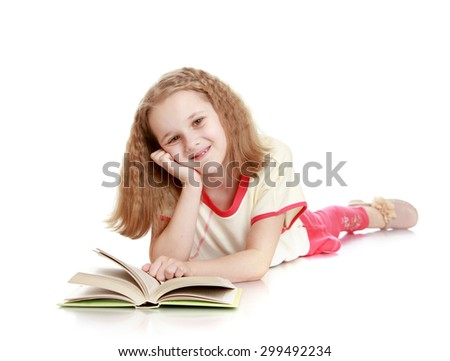 Beautiful blonde girl in a red suit lying on the floor leaning on the hand and is reading a thick book , the girl probably doing homework or reading adventure novels-Isolated on white background - stock photo