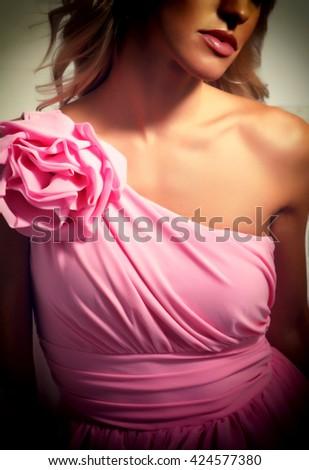 Beautiful blonde girl in evening dress pink - stock photo