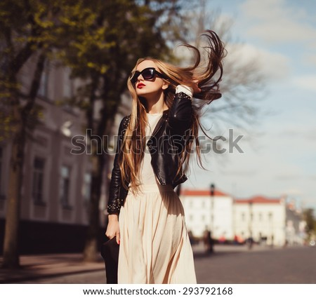 beautiful blonde girl in sunglasses posing with red lips on the street the wind in your hair sun street fashion clothing - stock photo