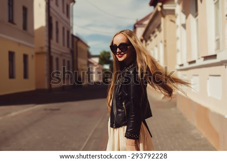 beautiful blonde girl in sunglasses posing with red lips on the street the wind in your hair sun street fashion clothing