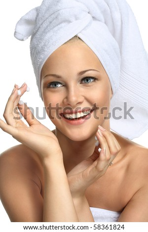 Beautiful blonde girl in towel - on white - stock photo
