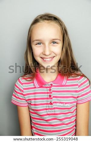 Beautiful blonde girl laughing - stock photo