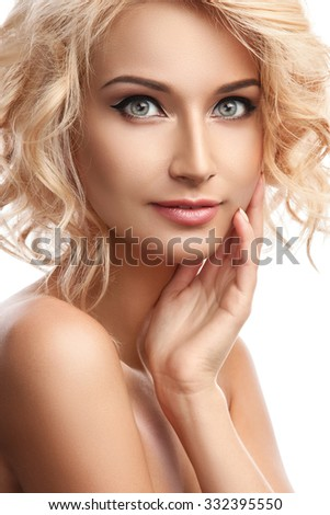 Beautiful blonde girl on white background
