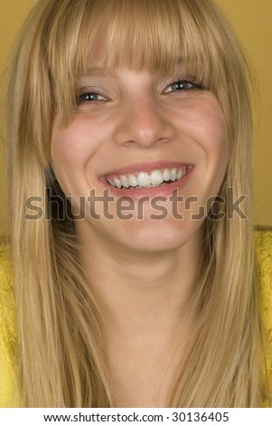 Beautiful blonde girl on yellow background
