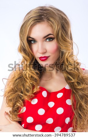 Beautiful blonde girl portrait in red long dress. Cute beautiful young woman