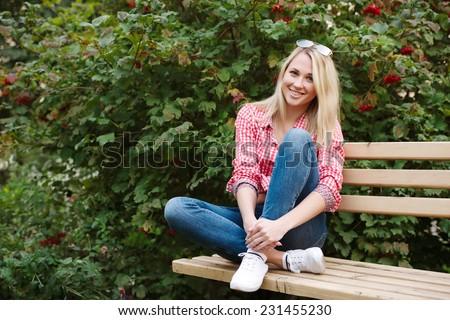 beautiful blonde girl portrait on the street - stock photo