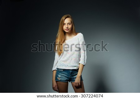 beautiful blonde girl studio portait on dark background - stock photo