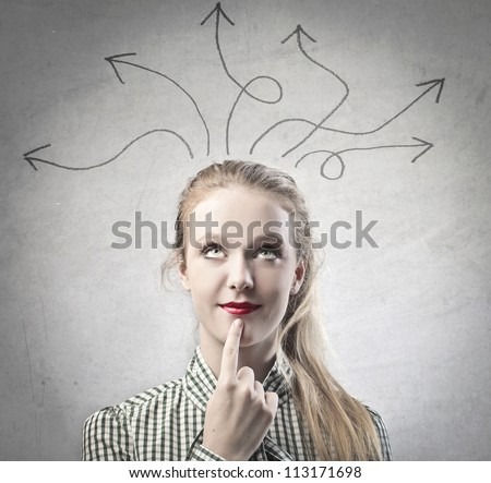 Beautiful blonde girl thinking a solution - stock photo