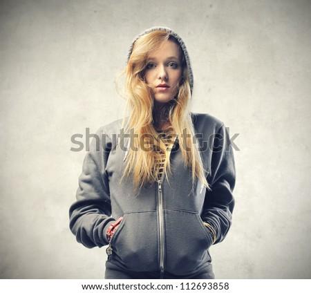 Beautiful blonde girl wearing a sweatshirt - stock photo