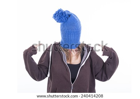 Beautiful blonde girl wearing blue bonnet and pointing - stock photo