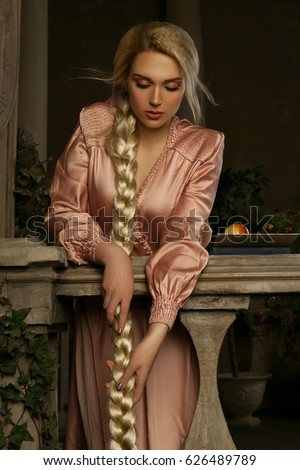 beautiful blonde girl wearing pink dress stock photo
