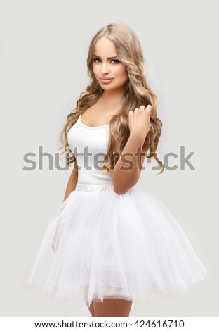 Beautiful blonde   girl wearing white  tutu skirt