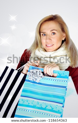 Beautiful blonde girl with christmas presents.