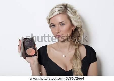 beautiful blonde girl with hair with blond hair, no make-up on a white background in studio