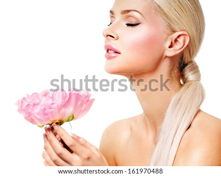 beautiful blonde girl with pink flower. perfect skin. - stock photo