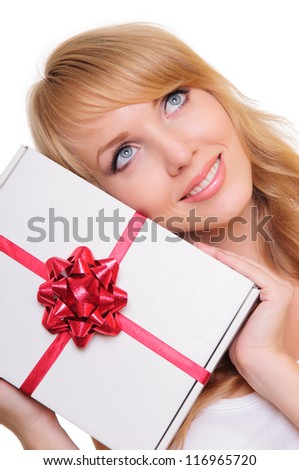 beautiful blonde holds a  gift box. Portrait isolated on white background