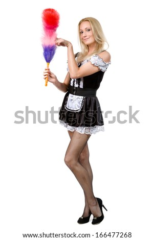 beautiful blonde in a dress of the parlourmaid and with a whisk in hands. Isolated on white - stock photo