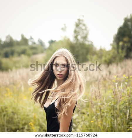 beautiful blonde in a field