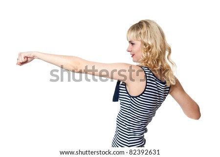Beautiful blonde in a pose of a boxer in a tight-fitting clothes isolated on white - stock photo