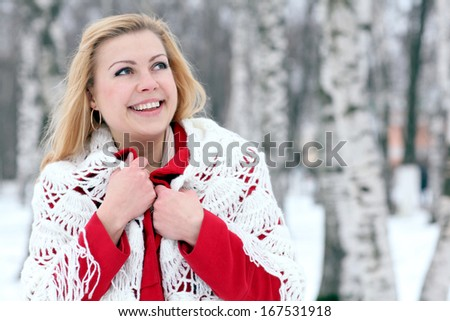 beautiful blonde in a traditional Russian scarf winter snow