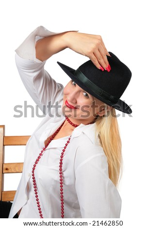 Beautiful blonde in black hat sits on chair - stock photo
