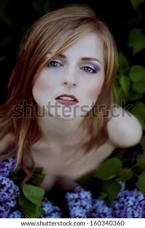 beautiful blonde in lilac bushes