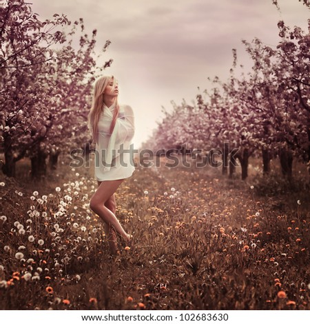 beautiful blonde in the garden in spring - stock photo