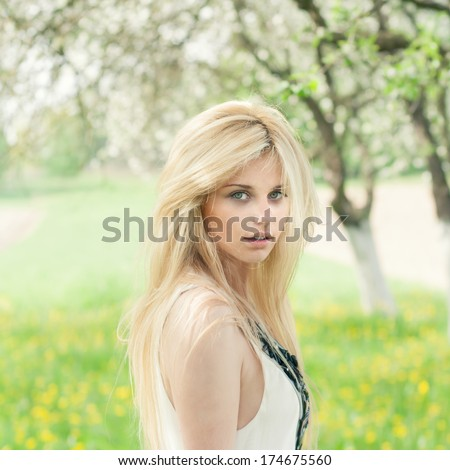 beautiful blonde in the spring garden - stock photo