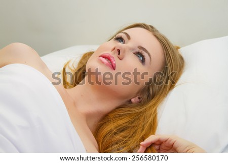 Beautiful blonde looking up at the world - stock photo