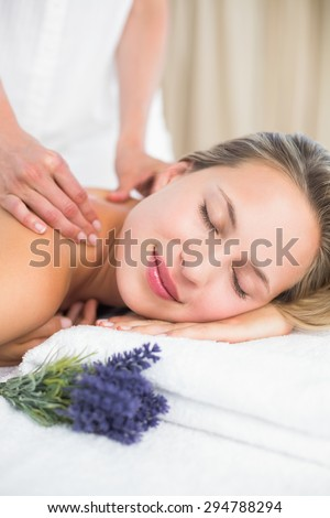 Beautiful blonde lying on massage table with lavanda at the health spa - stock photo