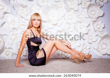 beautiful blonde model on a background of white flowers